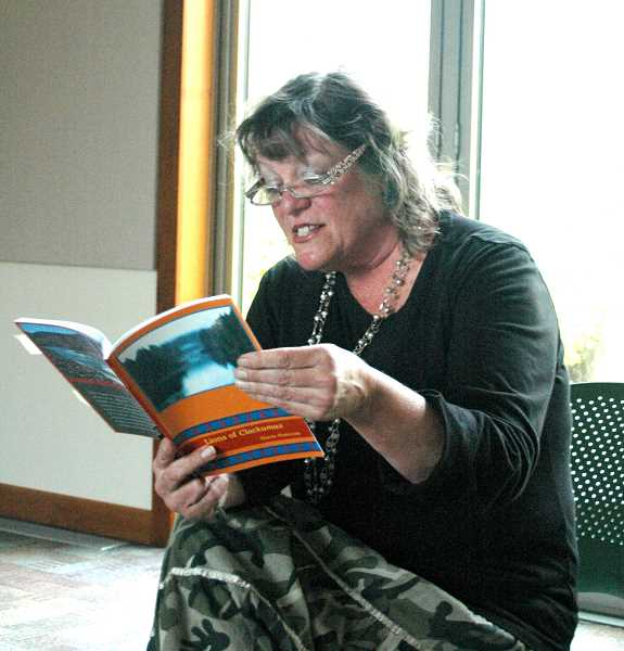 by: ISABEL GAUTSCHI - Stacia Hannum reads from her book 'Lions of Clackamas.'