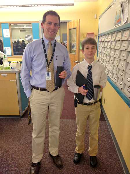 by: SUBMITTED PHOTO: MARCY WATTS - Lakeridge Junior High Principal Kurt Schultz shared his duties with two students this school year, including seventh-grader Evan Murray.