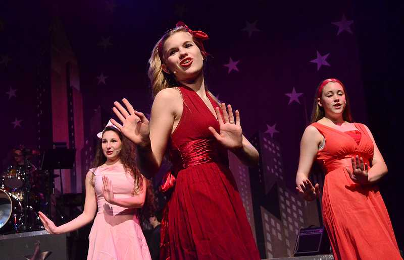 by: REVIEW PHOTO: VERN UYETAKE - Company members perform all-male and all-female numbers during their variety show, and many members dance, including: from left, Lilly Kritler, Bethany Neuman and Emma Bartel.