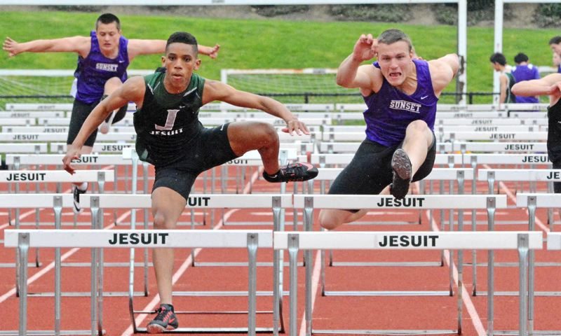 by: TIMES PHOTO: MATT SINGLEDECKER - Jesuit sophomore Julian Body beat Sunset senior A.J. Smith in the 110 hurdles on April 16 to help the Crusaders handily beat the Apollos at home.