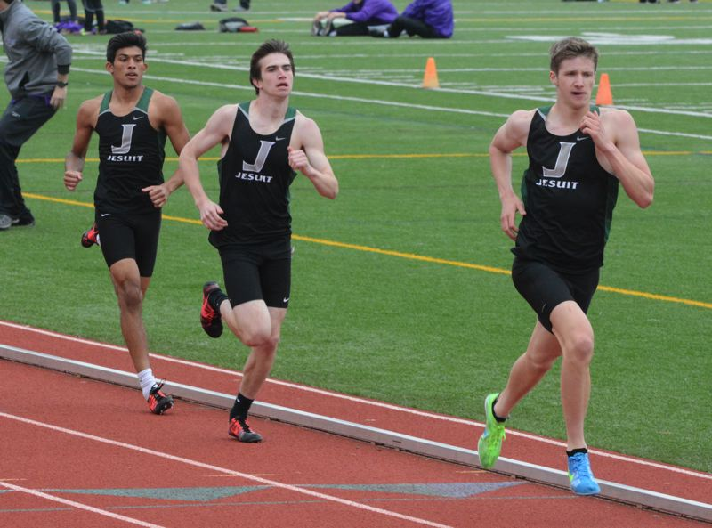 by: TIMES PHOTO: MATT SINGLEDECKER - Jesuit's Michael Godbout, Sam Remington and Sahil Doshi finished first, second and third in the 1,500.
