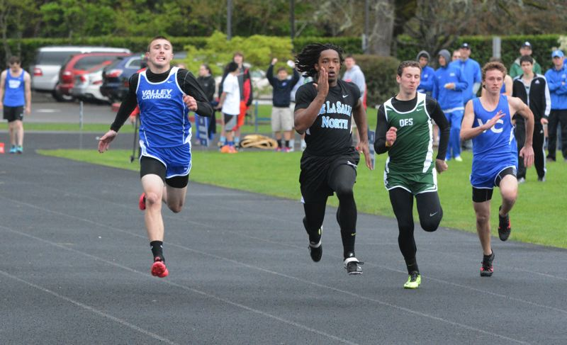 by: TIMES PHOTO: MATT SINGLEDECKER - Valley Catholic senior Jarrett Gray took second in the 100-meter dash and won the high jump by clearing 6-03 at the Valiants dual meet on Thursday.