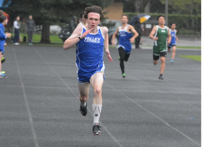 by: TIMES PHOTO: MATT SINGLEDECKER - Valley Catholic's Nathaniel Trobough won both the 400 and 800 for the Valiant boys track team on Thursday.