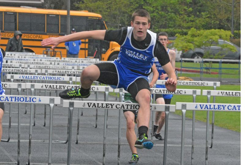 by: TIMES PHOTO: MATT SINGLEDECKER - Valley Catholic junior Tysen Prunty swept the 110-meter and 300-meter hurdles while also taking first in the long jump on Thursday.