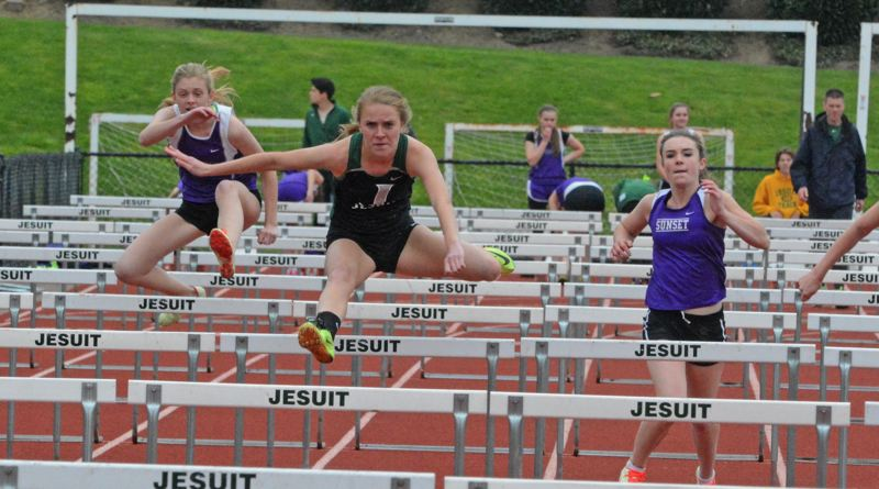 by: TIMES PHOTO: MATT SINGLEDECKER - Jesuit senior Abby Watcher took first place in the 100-meter and 300-meter hurdles and helped the Crusaders 4x400 relay beat Sunset on April 16.