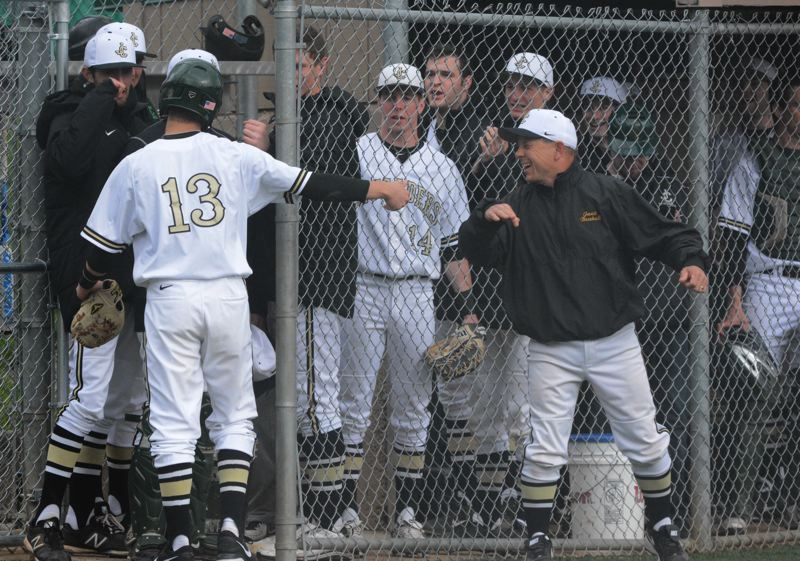 by: TIMES PHOTO: MATT SINGLEDECKER - Jesuit head coach Tim Massey celebrates with Donovan Baldocchi after the sophomore second baseman scored on a wild pitch against Westview on Wednesday.
