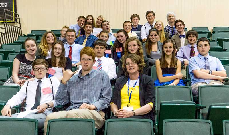 by: SUBMITTED PHOTO: PATRICK CORRIGAN - Riverdale High School's Model United Nations program is growing. Its members, advisor and chaperones are, from left: back row: Conor Scanlon, Leksi Kostur, Sophie Hamilton, Sean Corrigan, David Hugel, Kate Loggan (advisor); fourth row: Matous Komers, Adrian Lurie, Colton Mayberry, Ben Field, Holly Scrugham, Marty Agrimis; third row: Elisa Romano, Hugh Halvorson, Beatrice Solomon, Cindy Abrams, Talisha Ruffi, Nate Pereira; second row: Sarah Millender, Elizabeth Berry, Ben Mahler, Lilly Scanlan, Maddy Hauenstein, Ben Richmond; first row: Xander Klas, Greg Carlson, Shirley Brandon (chaperone).