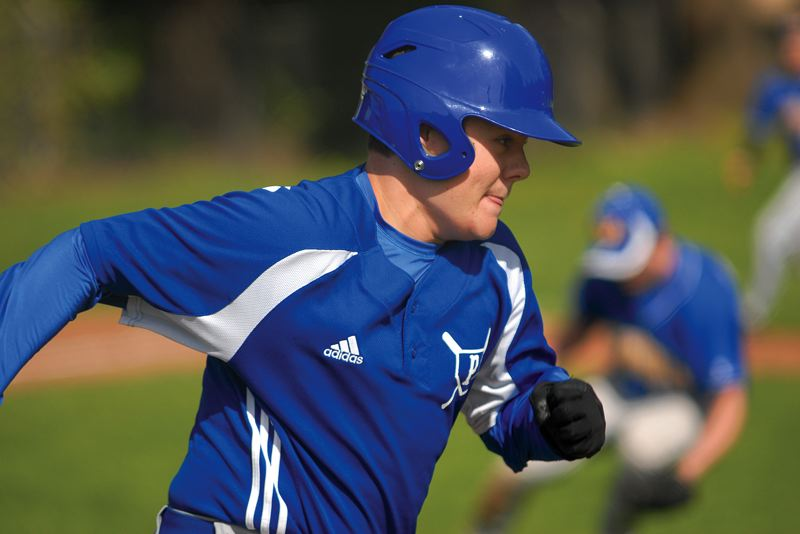 by: THE OUTLOOK: DAVID BALL - Portland Lutherans Christopher Lehr sprints down the first-base line during Fridays doubleheader with Vernonia.