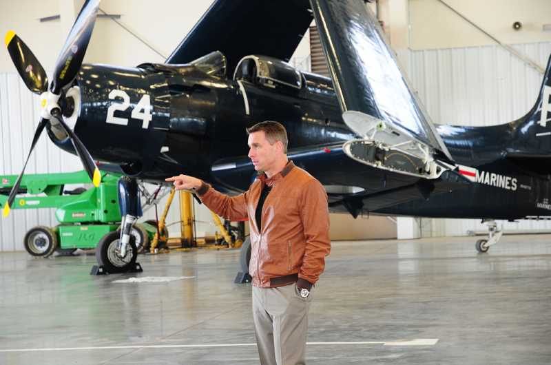 by: TOM BROWN - Kevin McCullough, co-owner of Erickson Aero Tanker, addresses participants during the EDCO tour of the company's business on April 16.