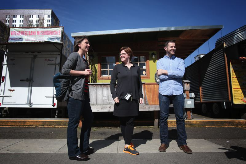 by: TRIBUNE PHOTO: JONATHAN HOUSE - Liz Hormann, B.D. Wortham-Galvin and Michael Coon hope to see the first public Street Seat program in the city to fruition at the food cart pod on Southwest Fourth Avenue, near PSU.
