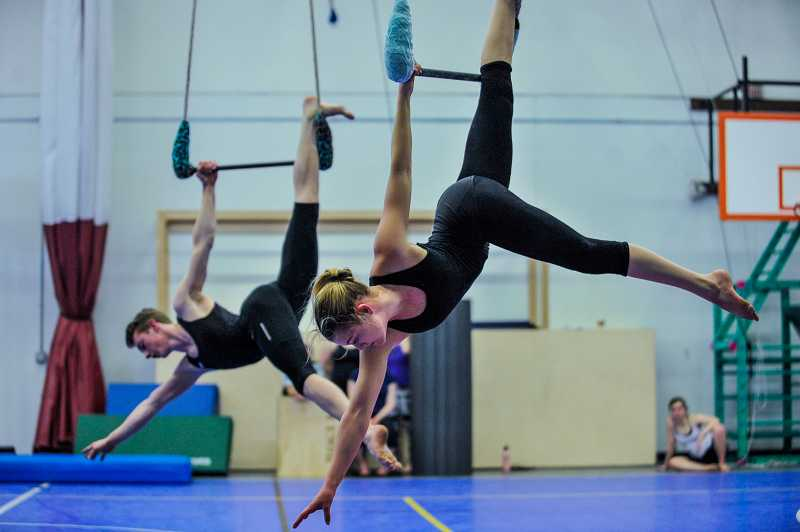 by: TIMES PHOTO: JOHN LARIVIERE - Rosie Rogmans (front) and Taylor Hill (back) perform a synchronized aerial routine on the trapeze.