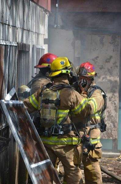 by: SUBMITTED PHOTO - Lake Oswego firefighters go into action while practicing a rescue operation at the building site of Kruse Village.