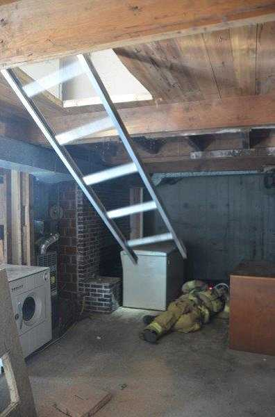 The victim on the floor is actually LOFD trainiing officer Randy Hopkins. Firefighters got to realistically simulate conditions of a basement rescue.