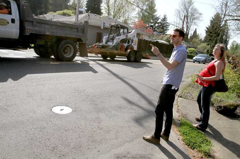 by: TIMES PHOTO: JONATHAN HOUSE - PSU student Jeremy Dalton points out a weak area of the walkability of the Fowler Middle School neighborhood, a section crossing Walnut Avenue that has limited visibility and no crosswalk.