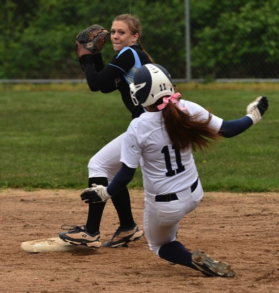 by: VERN UYETAKE - Lakeridge's Bailey Morris looks to turn a double play in the Pacers' victory last week.