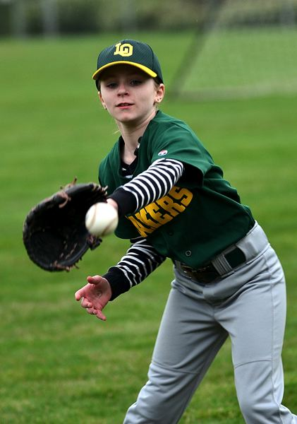 by: REVIEW PHOTO: VERN UYETAKE - Emily Schray is getting a lot of family support as she plays this summer as the lone girl in her little league.