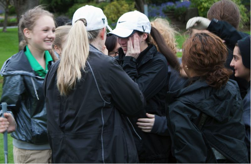 by: SUBMITTED PHOTO - TIGER TOGETHERNESS -- Tigard High School senior Erin Heath (center) gets a group hug from her Tiger teammates after she was awarded a pair of $3,000 scholarships.