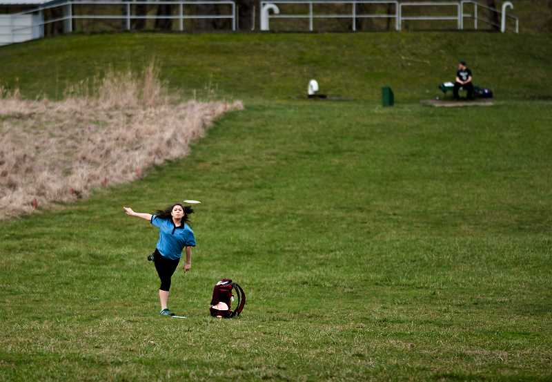 by: COURTESY PHOTO: FRED JOE - Michelle Nava fires a disc during training for disc golf. Nava, 13, a seventh-grader at Brown Elementary School, won the junior disc golf championship in Kansas last summer.