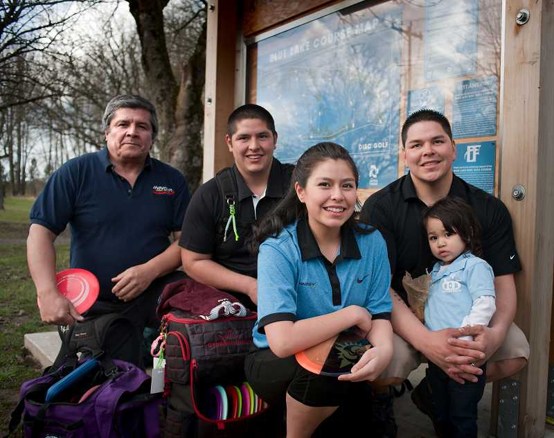 by: COURTESY PHOTO: FRED JOE - Michelle Nava frequently practices disc golf with her family, including (from left) her father, Luis Nava, brothers Andrew Nava and Luis Nava Jr. and niece Kiyari Nava.