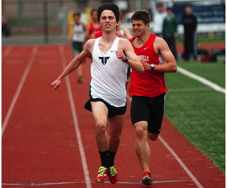 by: DAN BROOD - WINNER -- Tigard junior John Caufield sprints to the finish line to take first place in the 1,500-meter run in last week's meet.