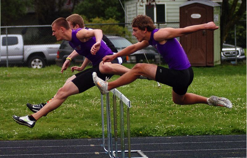 by: DAN BROOD - WINNING FORM -- Horizon Christian senior Blake Phillips is on his way to victory in the 110-meter high hurdles.