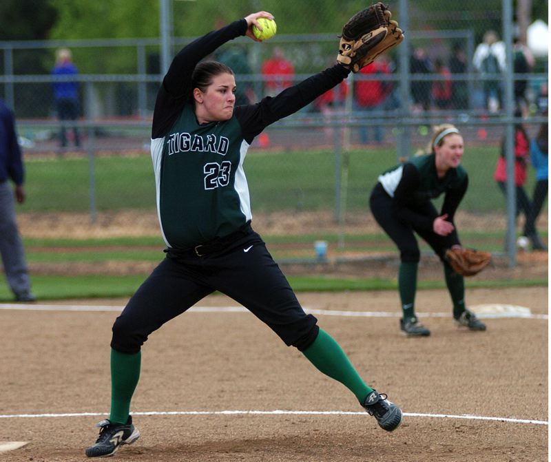 by: DAN BROOD - THE DELIVERY -- Tigard High School junior Lexi Kelly gets ready to fire a pitch to the plate during last week's game with Forest Grove. The Vikings got a 3-1 victory.