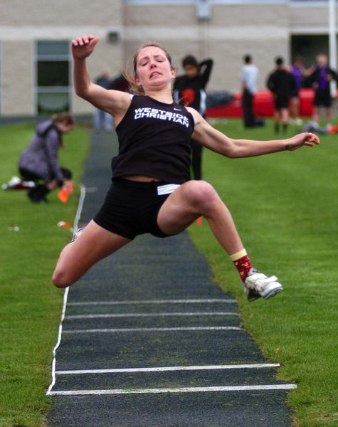by: DAN BROOD - JUMP TO IT -- Westside Christian's Kayla Brase takes off on her way to winning the long jump.