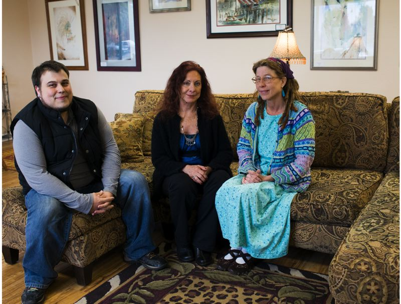 by: HILLSBORO TRIBUNE PHOTO: CHASE ALLGOOD - Will McEvoy, Jansu Hirst and Mary McDermott sit in the waiting room of Mundo Verde