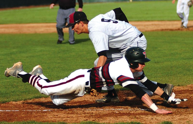by: PAMPLIN MEDIA GROUP PHOTO: DAN BROOD - Glencoe first baseman Trevor Williams puts a tag on Tualatin senior Joey Fishback during last Friday's Pacific Conference game.