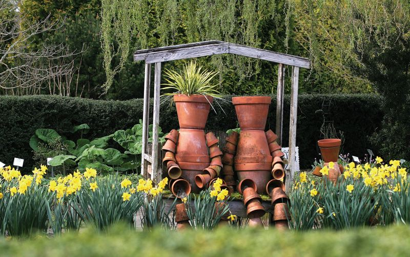 by:  JIM CLARK / PAMPLIN MEDIA GROUP - 'Mr. and Mrs. Pot' greet visitors to the Childrens Garden at the Oregon Garden.