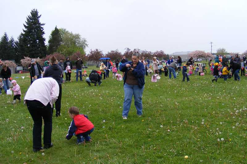 by: MOLALLA KIWANIS - Toddlers and parents find a field full of Easter eggs at the Molalla Easter Egg Hunt