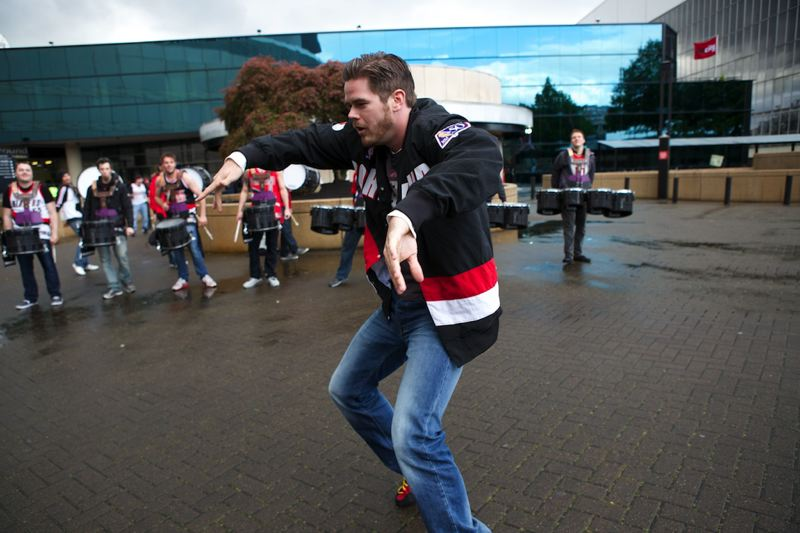 Shane Redman  of Salem dances to the beat of the Oregon Crusaders drum line.