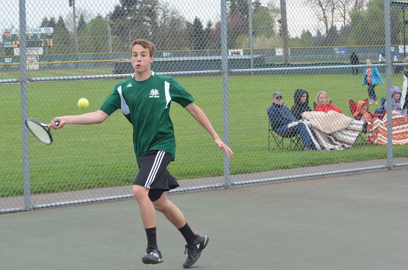 by: JEFF GOODMAN / FILE - Thanks in part to No. 1 singles player Austin Berkey (shown), the North Marion boys tennis team won its first four league matches of the season.