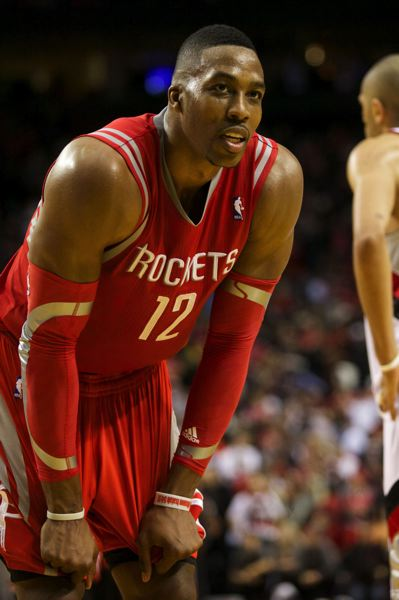 Houston center Dwight Howard turns to look at Blazers fans during overtime.