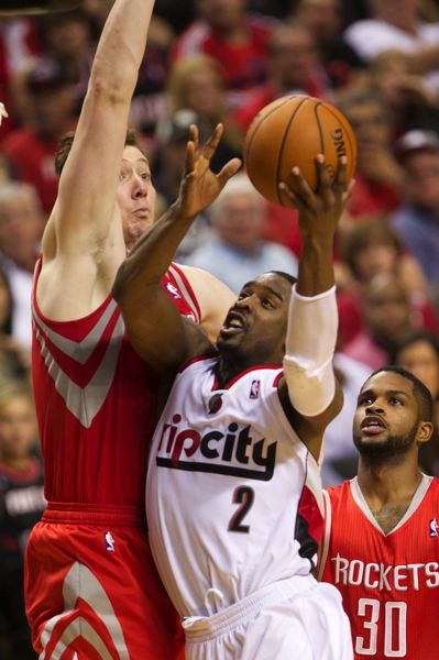 by: TRIBUNE PHOTO: JAIME VALDEZ - Wesley Matthews of Portland drives to the basket during Game 3 Friday night, only to have his shot blocked by Houston Rockets center Omer Asik.
