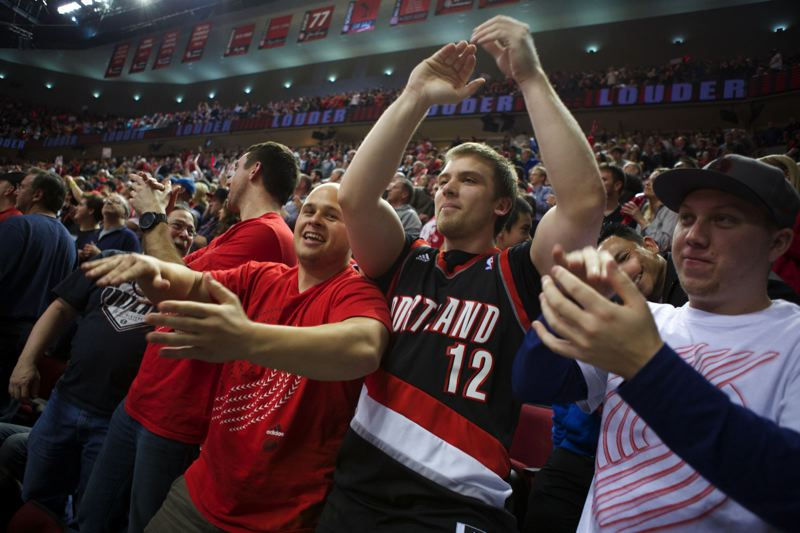 Blazers fans celebrate an OT run by their team.