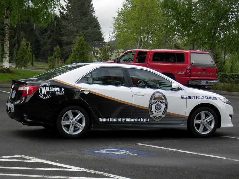 by: SUBMITTED PHOTO - PDX Wraps of Sherwood contributed graphic work to emblazon the police departments logo on the side.