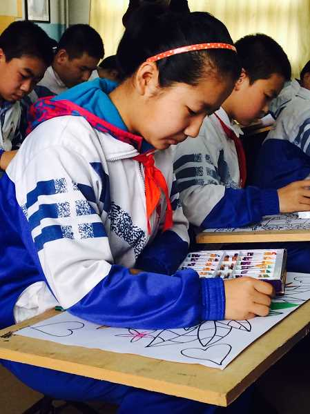 by: COURTESY OF HEATHER CORDIE - An elementary student in China's Fugu County shows her skill in her art 'special interest' class.
