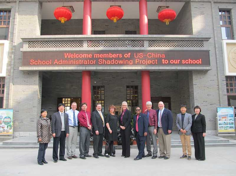 by: COURTESY OF HEATHER CORDIE - An Oregon team of administrators, including Sherwood Superintendent Heather Cordie (seventh from the left), visit Middle School No. 89 in Xi'an, China during a recent exchange trip to China.
