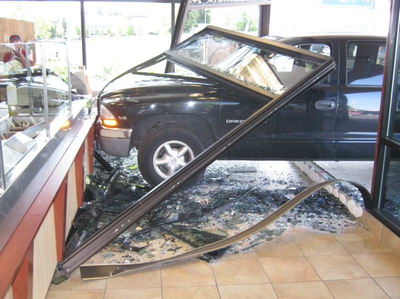 by: CONTRIBUTED: GRESHAM POLICE DEPARTMENT - A woman mistook her gas pedal for the brakes and drove through the Papa Murphy's Pizza on Burnside Saturday.