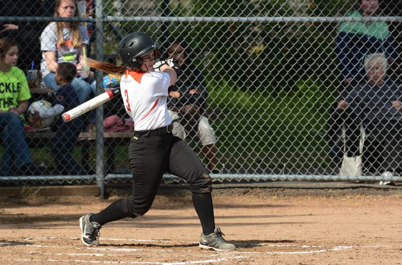 by: JOHN WILLIAM HOWARD - Freshman Nicole Lukinbeal takes a swing in the first inning, but to no avail. Tiger pitcher Molly Smith was relentless in the first leg of the double header, striking out 13 batters and giving up only two hits.