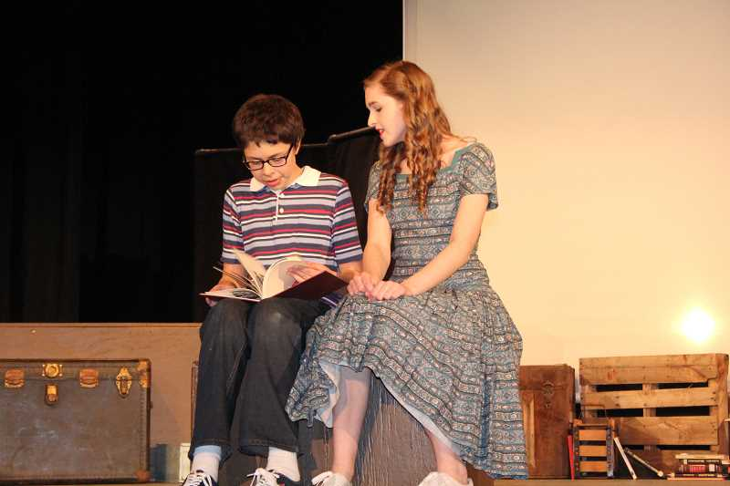 by: LINDSAY KEEFER - Luis Perez and Claire Blomberg perform a scene as the leads in 'Tomas and the Library Lady.'