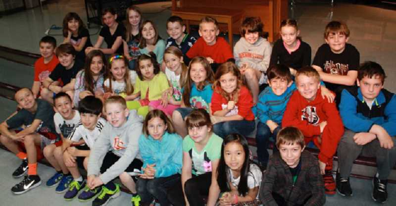 by: COURTESY OF BETH FARNUM - Ella Farnum (middle row, fifth from left) is surrounded by friends in this photo of Julie Camp's fourth-grade class at Middleton Elementary where she is a student.
