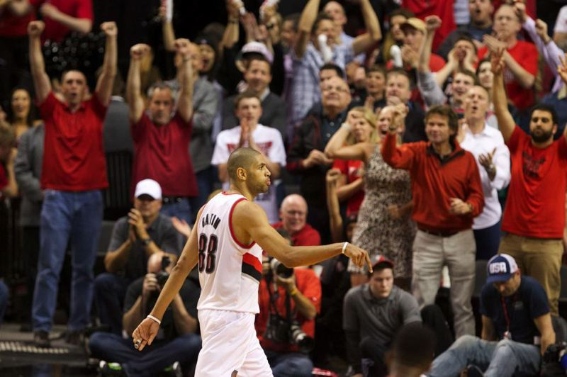 by: TRIBUNE PHOTO: JAIME VALDEZ - Nic Batum hears the roars of the crowd after sinking a 3-pointer in Game 4 of the Trail Blazers-Houston Rockets series at Moda Center.
