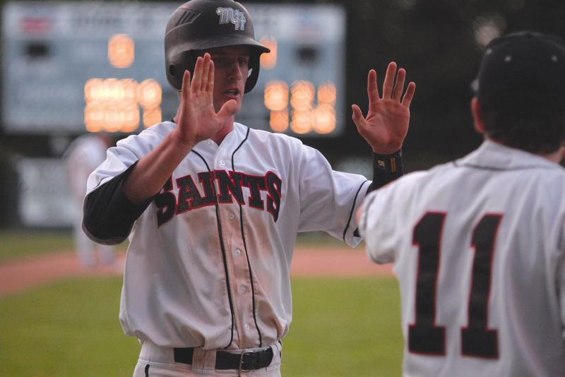 by: THE OUTLOOK: DAVID BALL - Mt. Hoods Logan Grindy celebrates the teams first run during Tuesday nights 3-0 home win over Chemeketa.
