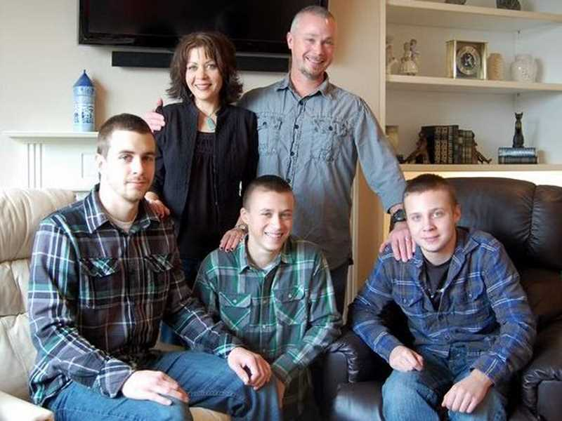 by: COURTESY PHOTO: HIGGINBOTHAM FAMILY - Sheyn Higginbotham (front left) poses for a family portrait with brothers Lucas (center) and Ethan, and parents Chantal and Chris.