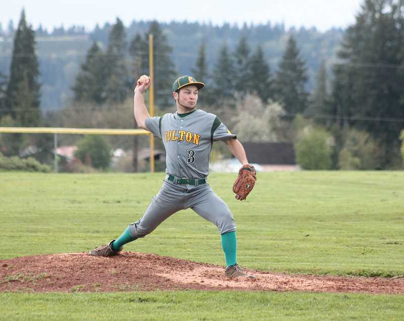 by: PHOTO BY JIM BESEDA/MOLALLA PIONEER - Colton's Drexler Hall tossed three shutout innings and was trying to protect a one-run lead in the seventh inning of last week's West Valley League home game against Sheridan when it started to rain -- hard -- and everything changed.