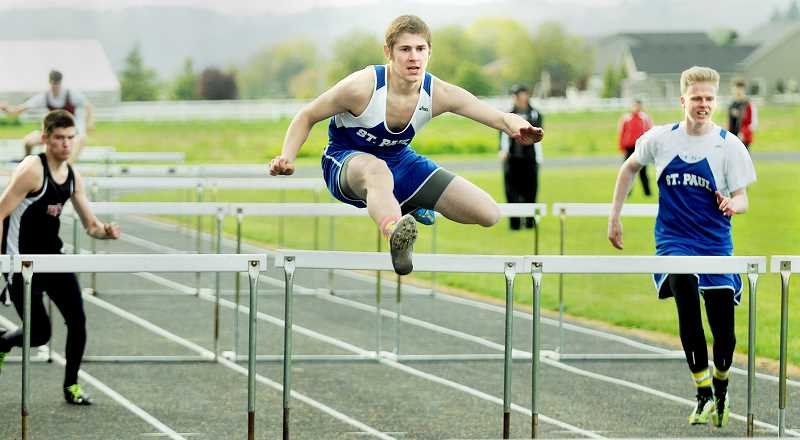 by: SETH GORDON - Up and over - Keenan Phillips easily clears the obstacle en route to winning the 100 hurdles at the Buckaroo Roundup April 24 in St. Paul.