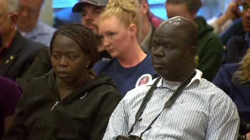 by: COURTESY PHOTO: MATT RASHLEIGH KOIN 6 PHOTOJOURNALIST - Sam Dilla (right) was among the many family members of Ayan Osman and Kidan Dilla who attended the meeting, where Pacific University President Lesley Hallick interrupted the technical discussions of traffic studies and project timelines to talk more about Kiden and Ayan - calling them shining stars who were destined to change the world - because its important that you remember who they were.