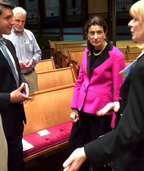 by: TRIBUNE PHOTO: PETER WONG - Former U.S. Sen. Olympia Snowe (center in pink), a Maine Republican, talks with audience members Tuesday evening after her speech at the Mark O. Hatfield Distinguished Historians Forum in Portland.